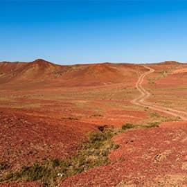 五彩湾位于昌吉州吉木萨尔县城北,在一片戈壁荒漠中有一个五彩缤纷的世界,那就是以怪异、神秘、壮美而着称的五彩湾。这是一幅大自然的杰作。千百年来,由于地壳的运动,在这里形成极厚的煤层,后几经沧桑,复盖地表的沙石被风雨剥蚀,使煤层暴露,在雷电和阳光的作用下燃烧殆尽,就形成了这光怪陆离的自然景观。